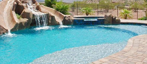 Pool w built in waterslides swimming pools a website about pools spas for Swimming pools with waterslides